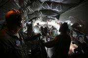 The crew prepares for the flight.
