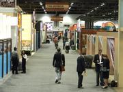 Real estate executives stop in one of the long hallways at the convention center to chat.