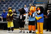 The mascots of the teams that play at the Bradley Center and BMO Harris Bank mascot Hubert watch the event.