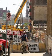 Contractors fenced off the Marriott site and are directing drivers on North Wisconsin Avenue around the construction operations.