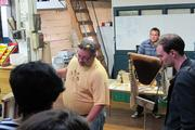 Charlie Koenen of Beepods.com, center, explains his company's beekeeping methods during the Bucketworks tour.
