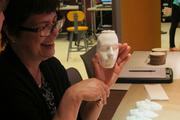 After the liquid plastic mixture dries, the final product is a cast of a face.