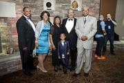 (From left) John Daniels III, Erickajoy Daniels, Irma Daniels, John Daniels IV, John Daniels Jr. of Quarles & Brady LLP and Wyman Winston of Wisconsin Housing and Economic Development Authority