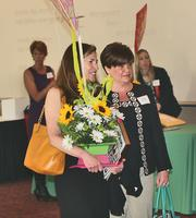 Mary Isbister of GenMet Corp., one of the Women of Influence winners, leaves the event with one of the centerpieces.