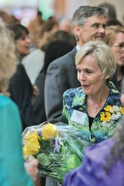 Suzanne Kelley, of the Waukesha County Business Alliance and a Women of Influence winner, accepts flowers.