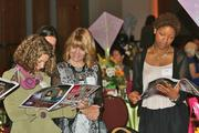 Several guests read the special awards section before the event.