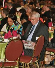 Milwaukee Mayor Tom Barrett reads the special awards section.