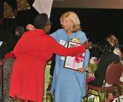 Cathy Jacobson, president and CEO of Froedtert Health and one of the Women of Influence winners, is congratulated by Sias.
