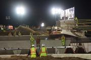 Construction crews watch as one of the two bridge spans is put into place.