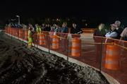 Onlookers stayed throughout the night to watch the work.