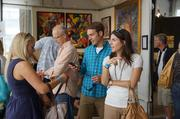 Visitors look at exhibits in the Milwaukee Art Museum.
