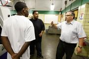 Tom Olson (right), an instructor at the Milwaukee Area Technical College  Click here for story