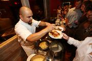 An 8-twelve MVP restaurant server hands out samples.