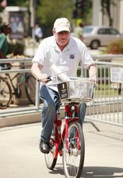 Tom Biedrzycki of B&G Carpet races in the Bike Courier for a Day bike competition.