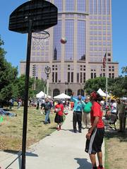 Joe'Mar Hooper from the city of Milwaukee intergovernmental relations department shoots some hoops.