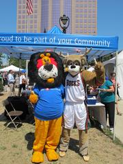 BMO Harris mascot Hubert the Lion (left) cozies up with Milwaukee Bucks mascot Bango.