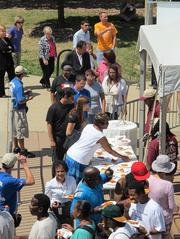 Employees take the free pizza, which was provided by Toppers Pizza.
