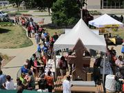 Lines form for free pizza at the noon start of the Office Challenge Games on Tuesday in Red Arrow Park.