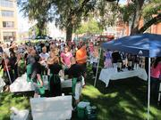 Hundreds of employees gather in Catalano Square Tuesday morning for coffee and cupcakes.