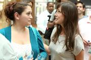 Angelica Vazquez, of Vibrant Graphics, and Kate Stroik, of Broadway Paper, wait in line for food and drink.