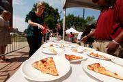 Downtown employees received free pizza from Tazino's Pizza and ice cream from Cedar Crest.