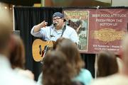 Zach Wade, of the Zach Wade Band, entertains the crowd.