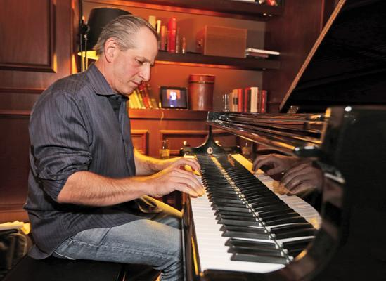 Marcus Corp. CEO Greg Marcus tickles the ivories for a jazz trio that performs at one of the company's hotels in Milwaukee.Click here for story.