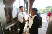 St. Marcus superintendent Henry Tyson greets students on their first day of school.   Click here for story.