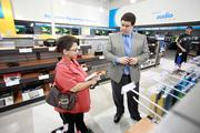 Michael Burdick, a sales manager of the Greenfield store, helps customer Kathy Borowski.