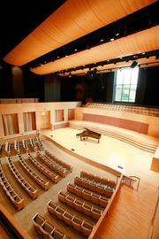 The 60-foot-high concert hall supports brilliant acoustics, assisted by adjustable absorptive panel curtains and silent mechanical systems.Click here for story.