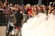 Chris Rayburn of 1 Wheel Revolution smokes the tires on his bike ....