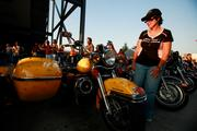"""Cindy McCann of Detroit checks out a """"Cheese"""" themed Harley-Davidson."""