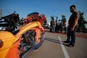 Murray Butt of Newfoundland, Canada, checks out a custom bike.
