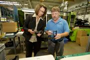 Doreen Lettau is the manufacturing ambassador for Dickten Masch Plastics  Inc., seen here with operations manager Bradley Anderson.Click here for story.