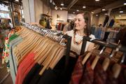 Lindsay Southern, a sales associate of Anthropologie, arranges clothing