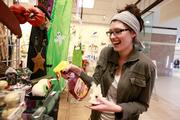 Village Shoppe employee Kylie Fish cleans Halloween eyeball decorations.   Click here for story.