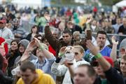 The crowd enjoys the opening acts of the Rock the Green music festival.