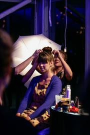 A guest gets her hair done at the Beauty Bar, which was sponsored by Neroli Spa.