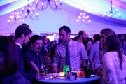 Guests socialize and network at the event.
