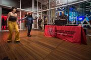Partygoers check out a dance floor set up at the event.