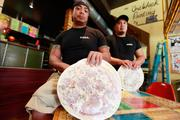 """Burgos and Smith call their product """"Milwaukee-style pizza,"""" with a crispy, flaky thin crust brushed with butter. Click here for story."""