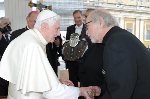Pope Benedict XVI blessed a pair of Harley-Davidson motorcycle gas tanks at the Vatican Wednesday as part of the company's upcoming 110th anniversary next year. On hand for the blessing was Willie G. Davidson, grandson of one of the company's founders.
