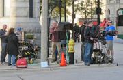 A film crew took over the southwest corner of East Wisconsin Avenue and North Jackson Street to film a Boston Store commercial Thursday morning.