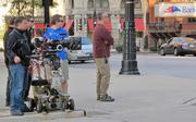 The crew shot video across East Wisconsin Avenue and timed their filming to when street lights stopped traffic on the downtown street.