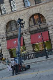 Cory Zimmermann of Z2 Marketing works the camera filming the exterior of The Pfister hotel.