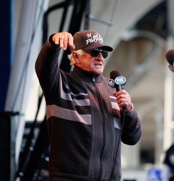 Milwaukee Brewers radio announcer Bob Uecker, shown here at the rally for the team's 2011 playoff appearance, will make an appearance in new commercials for Miller Lite, along with Mark Tauscher, the former lineman for the Green Bay Packers and Wisconsin Badgers.