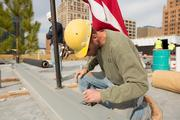 An oft-repeated ceremony in the local construction industry is to have workers sign their names onto the I-beam that will be placed at the highest point of a building's structure.