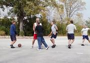 Employees of Mortara Instrument Inc. play basketball.