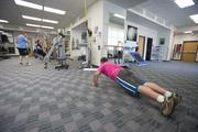 Aurora employees work out as part of the firm's wellness program.