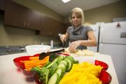 An employee prepares food at Diversified Insurance Services Inc. The firm tied for second place in the small company category.